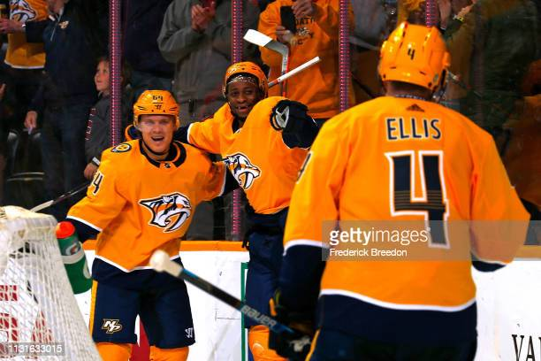 Wayne Simmonds of the Nashville Predators is congratulated by teammates Mattias Ekholm and Ryan Ellis after scoring a his first goal as a Predator...