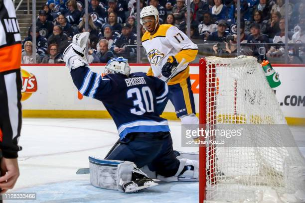 Wayne Simmonds of the Nashville Predators looks on as goaltender Laurent Brossoit of the Winnipeg Jets makes a glove save during third period action...