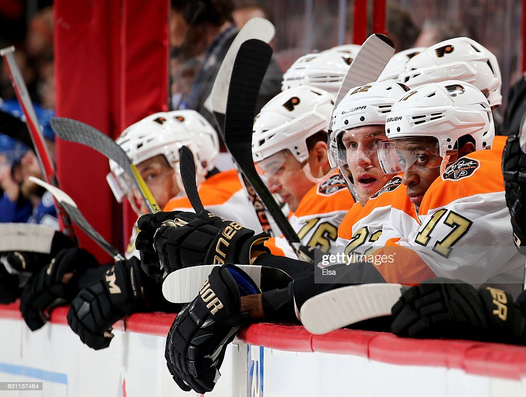Wayne Simmonds #17 of the Philadelphia Flyers and the rest of his teammates look on from the bench in the second period against the Tampa Bay Lightning on January 7, 2017 at Wells Fargo Center in Philadelphia, Pennsylvania.
