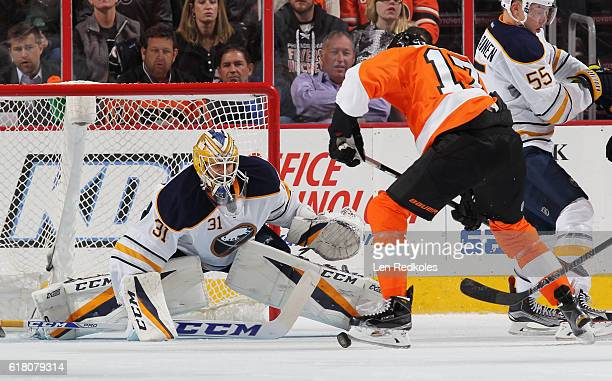 Wayne Simmonds of the Philadelphia Flyers attempts a scoring chance in front of goaltender Anders Nilsson of the Buffalo Sabres on October 25 2016 at...