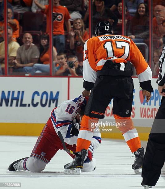 Wayne Simmonds of the Philadelphia Flyers attempts to fight with Sean Avery of the New York Rangers during an NHL preseason game at Wells Fargo...