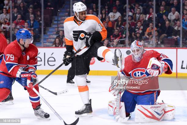 Wayne Simmonds of the Philadelphia Flyers attempts to screen on Peter Budaj of the Montreal Canadiens during the NHL game at the Bell Centre on...