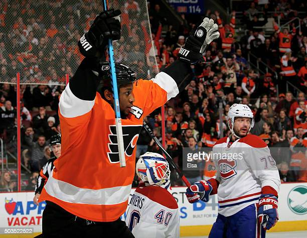 Wayne Simmonds of the Philadelphia Flyers celebrates his goal in the second period as Ben Scrivens and Andrei Markov of the Montreal Canadiens look...