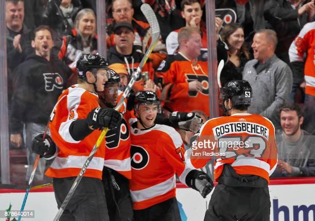 Wayne Simmonds of the Philadelphia Flyers celebrates his second period goal against the New York Islanders with teammates Samuel Morin Danick Martel...