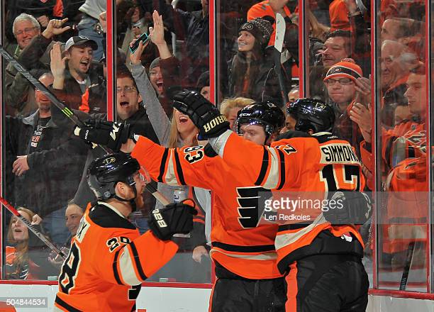 Wayne Simmonds of the Philadelphia Flyers celebrates his third period gametying goal against the Boston Bruins with teammates Claude Giroux and Jakub...