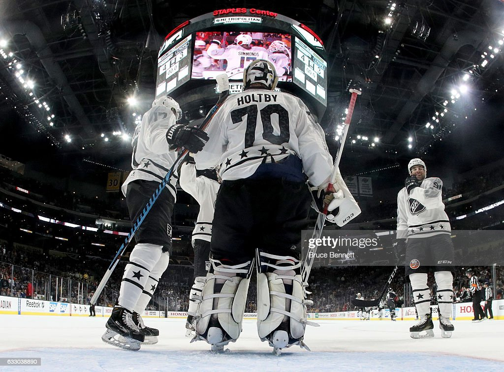 Wayne Simmonds #17 of the Philadelphia Flyers (L) celebrates with Braden Holtby #70 of the Washington Capitals after the Metropolitan Division All-Stars defeated the Pacific Division All-Stars 4-1 in the 2017 Honda NHL All-Star Tournament Final at Staples Center on January 29, 2017 in Los Angeles, California.