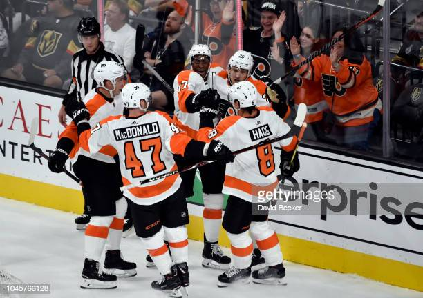 Wayne Simmonds of the Philadelphia Flyers celebrates with teammates after scoring a goal during the first period against the Vegas Golden Knights...