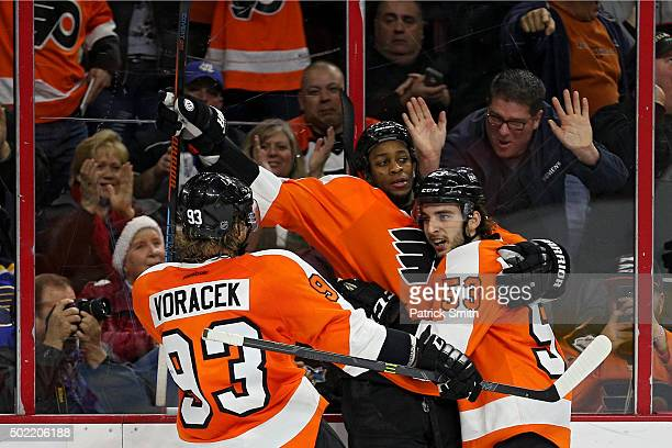 Wayne Simmonds of the Philadelphia Flyers celebrates with teammates Shayne Gostisbehere and Jakub Voracek after scoring a second period goal against...