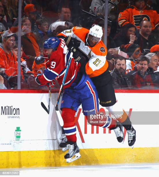 Wayne Simmonds of the Philadelphia Flyers checks Andrei Markov of the Montreal Canadiens during the second period at the Wells Fargo Center on...