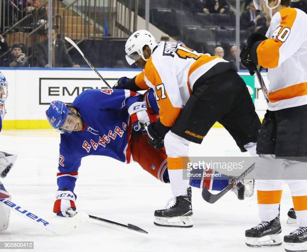 Wayne Simmonds of the Philadelphia Flyers checks Brendan Smith of the New York Rangers during the third period at Madison Square Garden on January 16...
