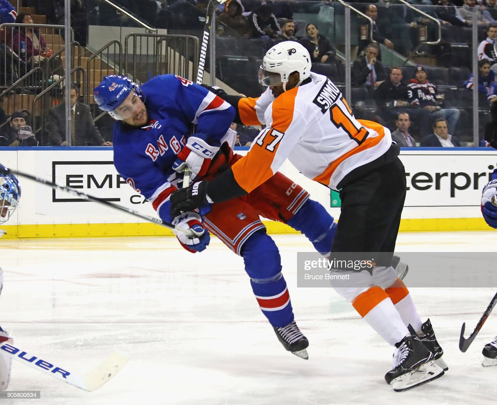 Wayne Simmonds #17 of the Philadelphia Flyers checks Brendan Smith #42 of the New York Rangers during the third period at Madison Square Garden on January 16, 2018 in New York City. The Rangers defeated the Flyers 5-1.