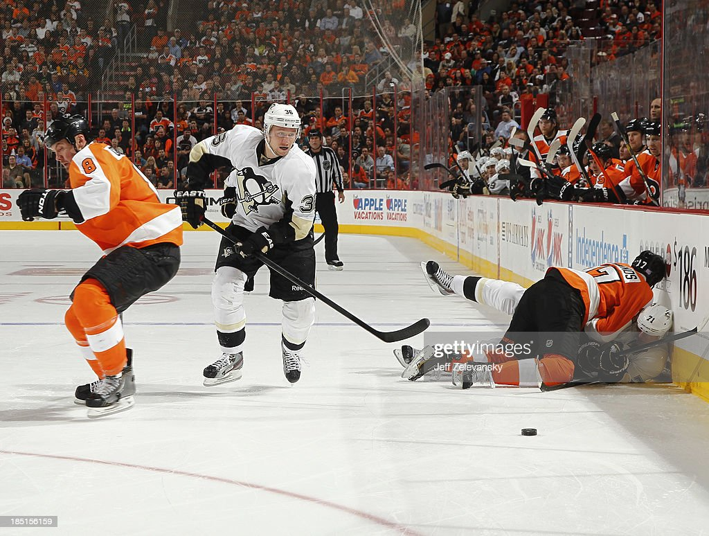 Wayne Simmonds #17 of the Philadelphia Flyers checks Evgeni Malkin #71 of the Pittsburgh Penguins in front of Jussi Jokinen #36 of the Pittsburgh Penguins at the Wells Fargo Center on October 17, 2013 in Philadelphia, Pennsylvania.