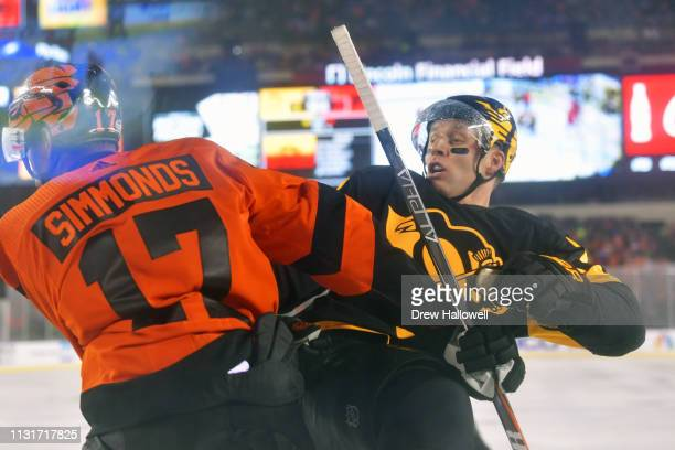 Wayne Simmonds of the Philadelphia Flyers checks Garrett Wilson of the Pittsburgh Penguins in the third period during the 2019 Coors Light NHL...