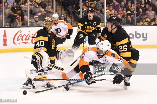 Wayne Simmonds of the Philadelphia Flyers fights for the puck against Brandon Calro of the Boston Bruins at the TD Garden on March 11 2017 in Boston...