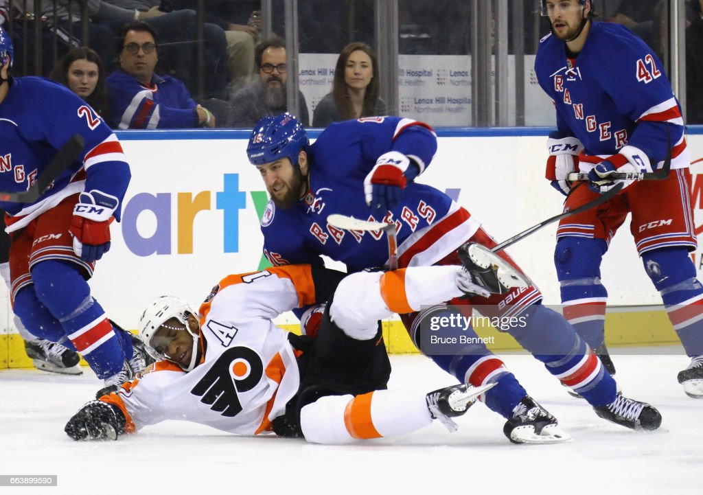 Wayne Simmonds #17 of the Philadelphia Flyers gets tangled up with Tanner Glass #15 of the New York Rangers during the third period at Madison Square Garden on April 2, 2017 in New York City. The Rangers defeated the Flyers 4-3.