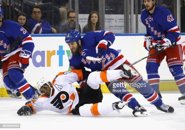 Wayne Simmonds of the Philadelphia Flyers gets tangled up with Tanner Glass of the New York Rangers during the third period at Madison Square Garden...
