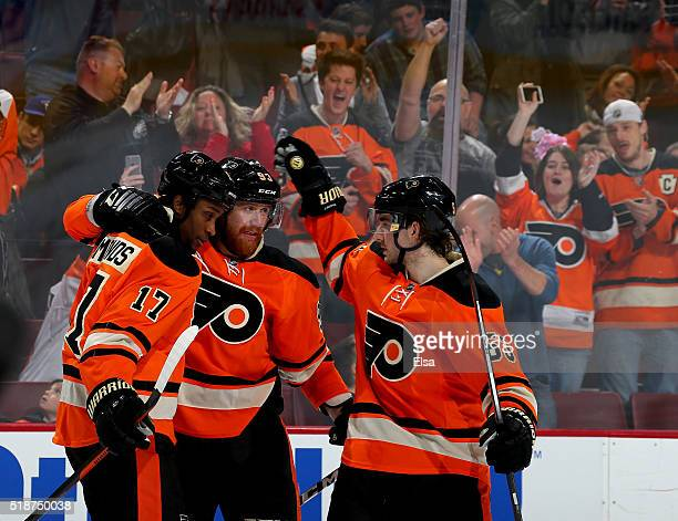 Wayne Simmonds of the Philadelphia Flyers is congratulated by teammates Jakub Voracek and Shayne Gostisbehere after Simmonds scored in the second...