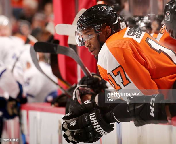 Wayne Simmonds of the Philadelphia Flyers looks on from the bench in the second period against the Toronto Maple Leafs on December 12 2017 at Wells...
