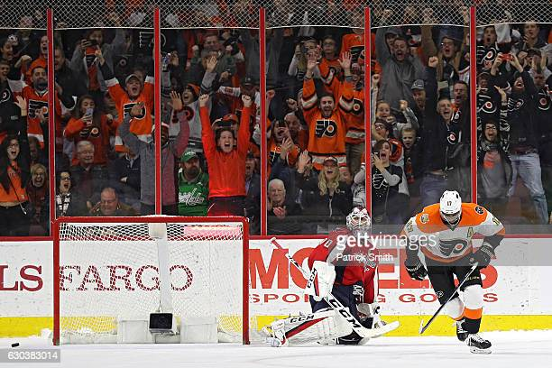 Wayne Simmonds of the Philadelphia Flyers reacts after scoring a goal on goalie Braden Holtby of the Washington Capitals during a shootout at Wells...