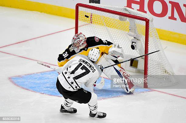 Wayne Simmonds of the Philadelphia Flyers scores a goal against Carey Price of the Montreal Canadiens during the 2017 Honda NHL AllStar Game...