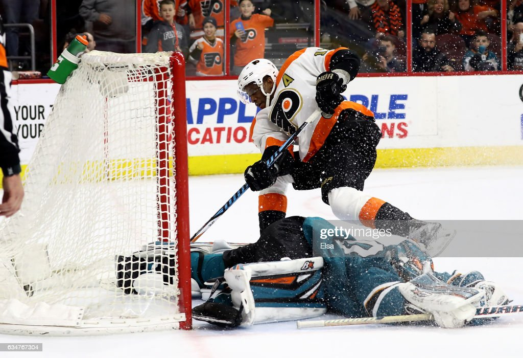 Wayne Simmonds #17 of the Philadelphia Flyers scores the game winning goal in overtime as Aaron Dell #30 of the San Jose Sharks defends on February 11, 2017 at Wells Fargo Center in Philadelphia, Pennsylvania.The Philadelphia Flyers defeated the San Jose Sharks 2-1 in overtime.