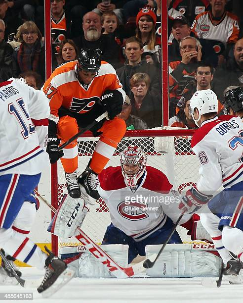 Wayne Simmonds of the Philadelphia Flyers screens Carey Price of the Montreal Canadiens during the first period at the Wells Fargo Center on December...