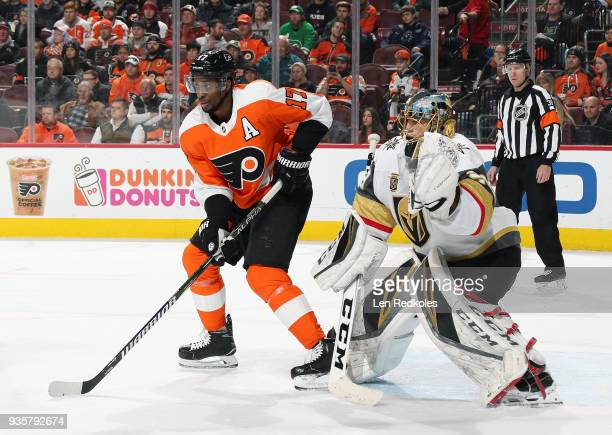 Wayne Simmonds of the Philadelphia Flyers sets up in the crease against MarcAndre Fleury of the Vegas Golden Knights on March 12 2018 at the Wells...