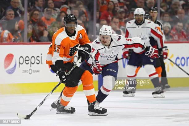 Wayne Simmonds of the Philadelphia Flyers skates past Dmitry Orlov of the Washington Capitals during the first period at Wells Fargo Center on March...