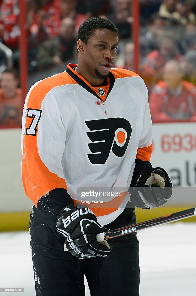 Wayne Simmonds #17 of the Philadelphia Flyers skates to the bench after getting a high stick to the face during the game against the Washington Capitals at the Verizon Center on February 1, 2013 in Washington, DC.