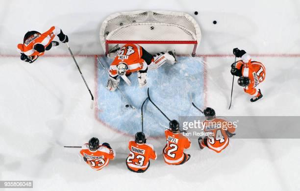 Wayne Simmonds Shayne Gostisbehere Brandon Manning Michael Raffl Oskar Lindblom Scott Laughton and Alex Lyon of the Philadelphia Flyers warm up...