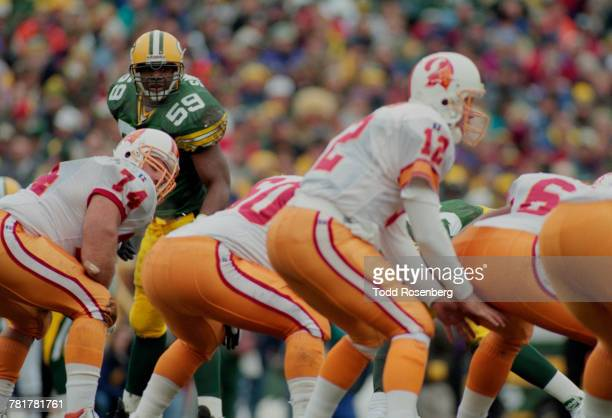 Wayne Simmons Linebacker for the Green Bay Packers looks directly at Trent Dilfer Quarterback for the Tampa Bay Buccaneers as he calls the play on...