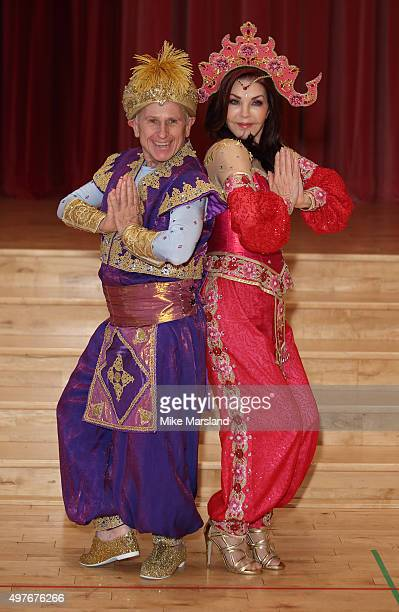 Wayne Sleep and Priscilla Presley attend a photocall for Aladdin at Milton Keynes Theatre on November 18 2015 in Milton Keynes England