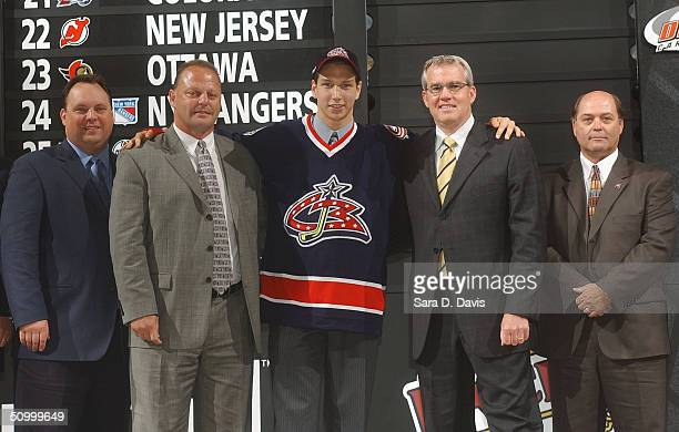 Wayne Smith, Gerard Galbert, #8 overall draft pick Alexandre Picard, Doug MacLean and Don Boyd of the Columbus Blue Jackets pose during the 2004 NHL...