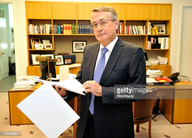 Wayne Swan Australia's treasurer stands for a photograph with his speech in his office at Parliament House in Canberra Australia on Tuesday June 7...
