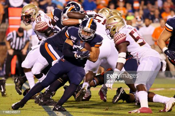 Wayne Taulapapa of the Virginia Cavaliers rushes in the first half during a game against the Florida State Seminoles at Scott Stadium on September 14...