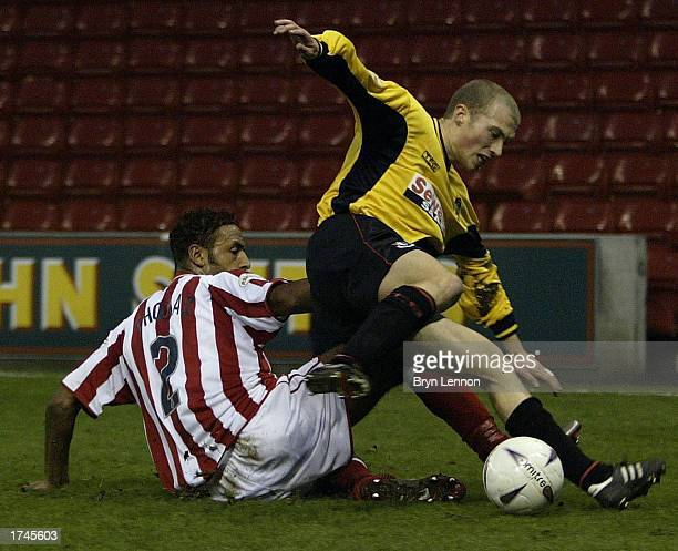 Wayne Thomas of Stoke tackles Warren Feeney of Bournemouth during the FA Cup Fourth Round game between Stoke City and AFC Bournemouth at Britannia...