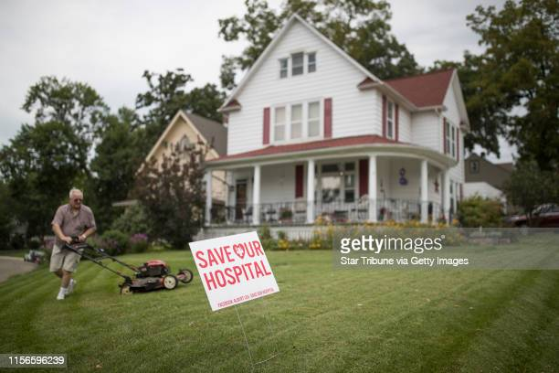 Wayne Thorson mowed his lawn that has a Save Our Hospital sign in the front yard Thursday August 242017 in Albert Lea MN The Mayo Clinic's plan to...