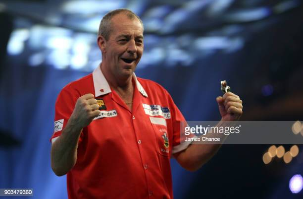 Wayne Warren of Wales celebrates victory during Day Four of the BDO World Darts Championship at Lakeside Shopping Centre on January 10 2018 in...