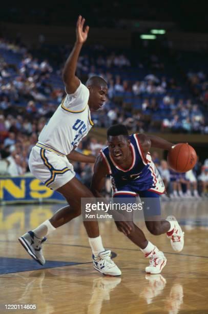Wayne Womack, Forward for the University of Arizona Wildcats dribbles past Gerald Madkins, Guard for the University of California, Los Angeles UCLA...