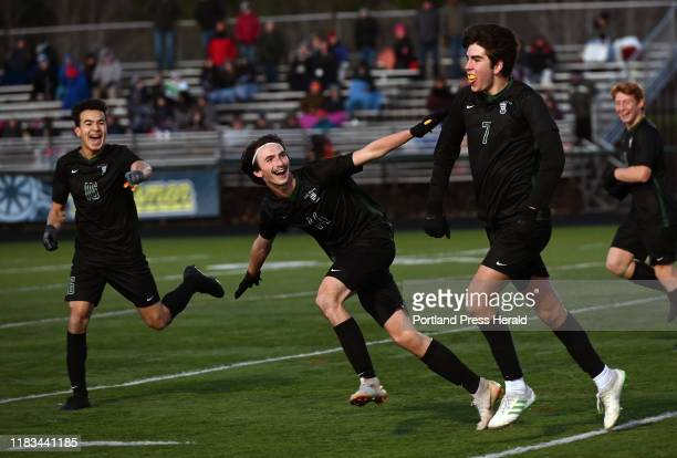 Waynflete's Patty Shaw Joey AnselMullen and Aiden Kieffer celebrate after Kieffer scored a second half goal against Mt View in the Class C State...