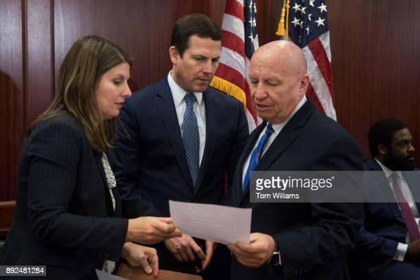 Ways and Means chairman Rep Kevin Brady RTexas right talks with aides Allison Halataei and David Stewart before the SenateHouse Conference Committee...