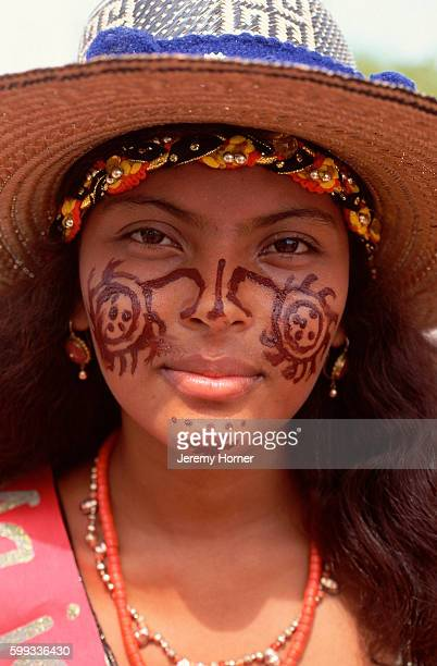 A Wayuu woman with traditionally painted patterns on her face The painting is reserved for special occasions