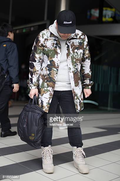 Wazzy attends the Anne Sofie Madsen show during Tokyo Fashion Week wearing an Off White jacket Yeezy shoes Jjjound hat Solo East glasses and Porter...