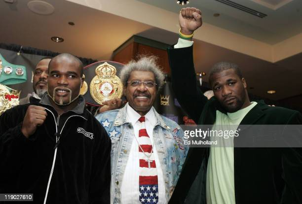 Ring Magazine Cruiserweight Champ JeanMarc Mormeck and IBF Cruiserweight Champ O'Neill Bell pose with promoter Don King at the presser announcing...