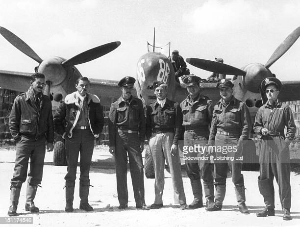 W/Cdr Adrian Warburton DSO DFC poses with the first USAAF unit on Malta American pilots lr German Spencer Sculpone Webb Sugg Bury 2nd April 1943 Malta