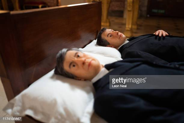 """We"""", a double self-portrait of the artist Maurizio Cattelan in bed, is seen at Blenheim Palace on September 12, 2019 in Woodstock, England. The..."""