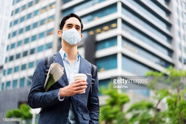 we are breathing bad air - air respirator mask stock pictures, royalty-free photos & images
