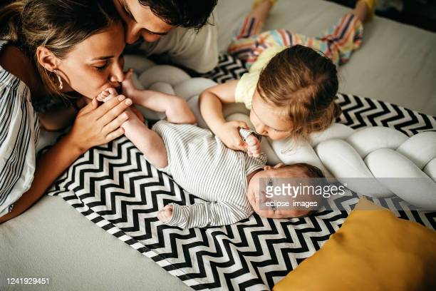 we are cute family - kissing feet stock pictures, royalty-free photos & images