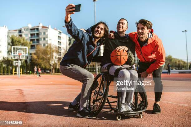 we are happy to play - wheelchair stock pictures, royalty-free photos & images