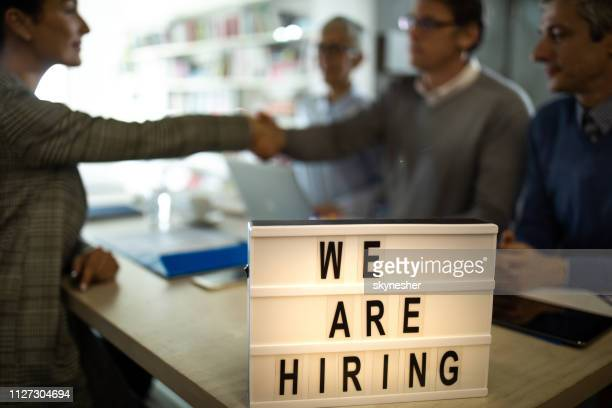 we are hiring! - help wanted sign stock photos and pictures